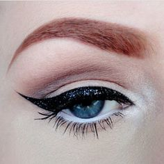 Put an NYE spin on the classic cat-eye by dabbing some iridescent glitter on top!  Photo by nicola_kate. #nyemakeuptips