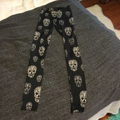 Skeleton pattern legging White and black skeleton patterns all over the leggings. Very stretchy material. Tight fitting. Divided Pants Leggings