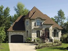Apple Hill European Home. Beautiful exterior, wonderful castle look! Breakfast island w/ range, no bar - island w/ stove. Office, great/living room, sitting room. 2nd floor bedrooms, master bath seems to connect without a doorway. Large walk-in closet (though diagonal), loft over great room. $251k cost, 2281 sq ft.