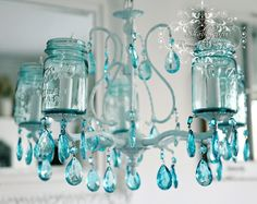 Can't get enough of these vintage turquoise colored mason jars...so versatile & beautiful!