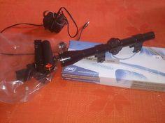 Lunette de visée (valeur 25€)+ une visée laser hs 1€  Un chargeur 9 volts 50 cts.