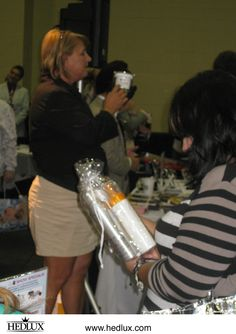 """GKhair demonstrated at the """"Lux Lounge"""" (HedLux) booth during the 2012 CEA Convention.    Visit www.hedlux.com and use code LUXLOVE for 25% off retail purchases - including hair extensions!"""