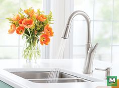 With its exceptional form and uncomplicated style, the Moen® Benson Single-Handle Kitchen Pulldown Faucet adds a polished look to any room. The faucet features a unique, pull-down design that automatically retracts and secures to the dock while providing 50% more spray power than other pulldown faucets. In a Spot® Resist Stainless Finish, this faucet resists fingerprints and water spots so your kitchen will always seem clean.