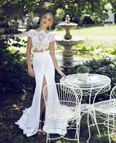 Glamorous two piece summer wedding dress with lacey short sleeve top and wrap style long skirt with a slit #Summer #Fashion #Brides #Wedding #White