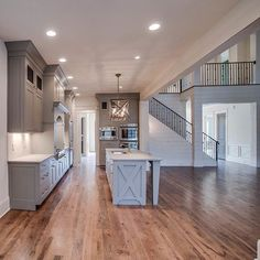 """X"" marks the spot in this home!! Island, light and wainscoting are just are few great features in this home! #chandelierdevelopment #reclaimedwood #custom #the_real_houses_of_ig @matt_a_perkins @lauraperkins"