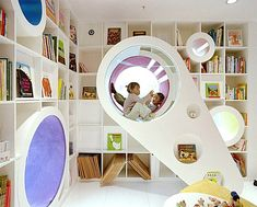 A circular motif becomes a life-sized loft module in this next creative space. Notice how the outside of the structure has round insets that hold books and toys.