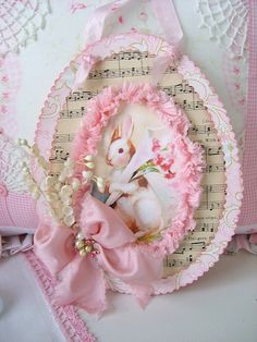 Love this!  What's not to love...cute bunny, vintage sheet music, lace, and pink, pink, pink...:)