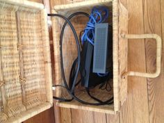 Hide your modem and router inside a decorative basket. The lid serves as protection from dust. Created and posted by Crys Galivan.