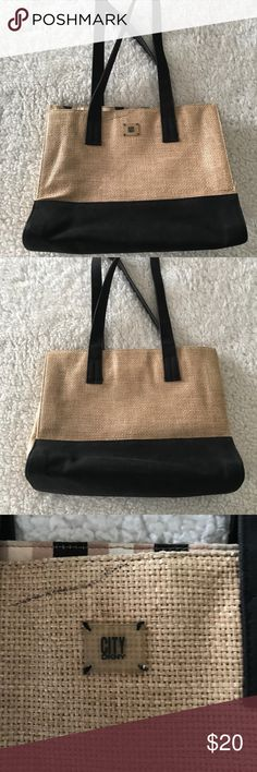 CITY DKNY straw and black shoulder bag Hardly used , straw and black city dkny shoulder bag .  Striped inside Dkny Bags