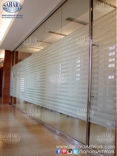 Office door and partitions, made from clear glass & sandblasted stripes, with ROYAL° handles and accessories.