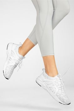 Put your best foot forward in our performance sneaker, built with a padded insole and knit upper for ultimate breathability and flexibility. Padded insoles for optimal comfort White Leopard, New Albany, Sweat It Out, Workout Accessories, Kate Hudson, Complete Outfits, Training Shoes, White Shoes, Cheetah Print