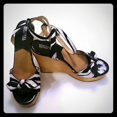 """Michael Kors Blk/Wht Bow Tie Wooden Wedges These are a keeper! Set the trend by sporting these sassy wedges by Michael Kors. Classy tie at toe and ankle has wrap back strap. Signed Michael Kors along the back of wedge.Size 8 Made in Brazil Fabric/Leather Upper Wooden Wedge  Approximately 5"""" wedge heel. In extremely good condition. MICHAEL Michael Kors Shoes Wedges"""