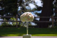 Flower pillar by @CailynDelovely at @weddingsatsgcc