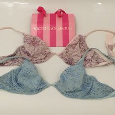 Lot of 2 Victoria's Secret bra bralette size 36c Lot of 2 bra bralettes from Victoria's Secret. Size 36c in blue and pink snake skin pattern. Lightly lined with underwire support and fit great like a bikini top. Barely worn and great condition. Victoria's Secret Intimates & Sleepwear Bras