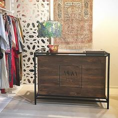 Cashier desk with storage baskets implemented as our client requests #byinsideout #woodwork #logoprint #rustic #oldwood de insideout.uae