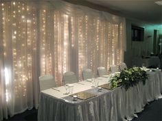 LED-lighted curtain : You can buy curtains like this or make them; use silver organza fabric for extra glam and shimmer