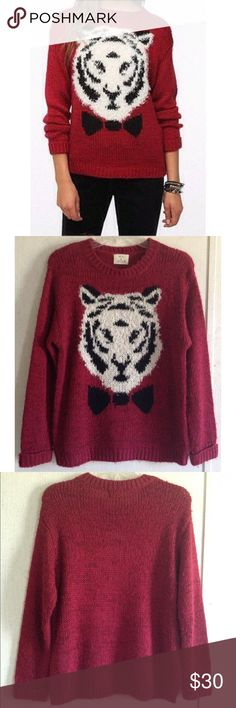 Pins and Needles Tiger Sweater Good condition. Quite a bit of pilling/fluffing on the knit. Super cute Pins and Needles sweater from Urban Outfitters. Large white tiger wearing a bow tie on the front. Fluffy threads like fur on the tiger. Burgundy knit allover with some flecks of red. Long sleeves that are cuffed at the end. Size medium. All offers welcome Urban Outfitters Sweaters Crew & Scoop Necks