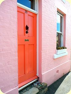 pink wall and orange door