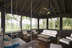 This North Carolina screened-in porch is a relaxing pavilion in the trees. I imagine many great naps take place on the hanging bed.