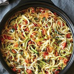 Zucchini noodles and regular noodles combine for a lightened up Italian dinner.