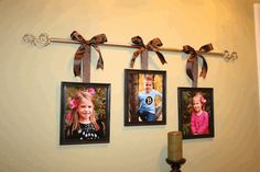 """Curtain Rod Hanging Frames This is such an adorable way to hang pictures – with a curtain rod and ribbon! Take an old curtain rod and picture frames to make this awesome room decoration. Perfect idea for my """"no empty chairs"""" wall. Home Projects, Home Crafts, Diy Home Decor, Diy Crafts, Thrifty Decor, Hanging Frames, Hanging Pictures, Framed Pictures, Family Pictures"""