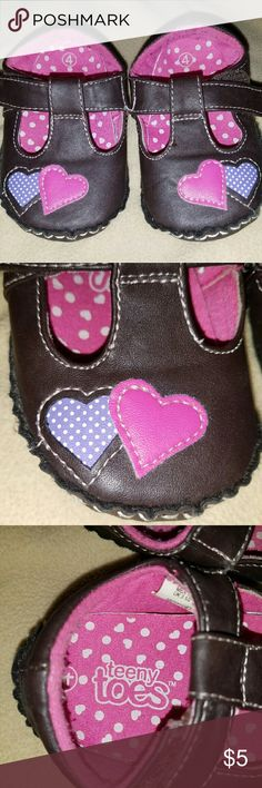 Brown Heart Baby Shoes They look a big like mary jane moccasins! These cute lil brown shoes has pink and purple heart detail on the top and bottom of shoes! Still in great condition! Teeny Toes Shoes Baby & Walker