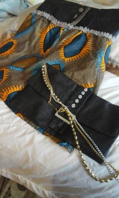African print skirt box leather pleated front with matching clutchbag by 0781972659 cell no