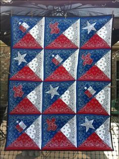 Texas Bandana Quilt. Red, white, and blue bandanas cut and re-assembled as Texas flags. I also used bandana in the flag, star, and Texas.