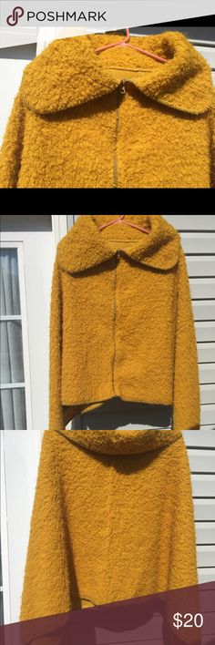 zip up poncho Fuzzy Mustard lightweight poncho.     100% polyester . Has a 70s vibe. Jackets & Coats Capes