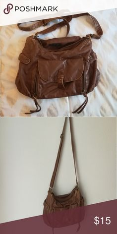 Brown Purse w/ Convertible Strap Brown convertible strap Bueno brand purse. Converts from a crossbody to a shoulder bag. Has two interior pockets, and two large compartments. No staining or major rips inside or out, only normal wear and tear.  Check out my other listings for more items and bundle deals! Bueno Bags Crossbody Bags