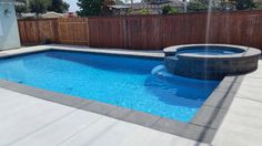 Pool by Lancon. Coping is pour in place concrete with charcoal color sand finish. Deck is standard gray color concrete with a light broom finish. Contrasting Grays make the Caribbean blue mini pebble plaster finish stand out!