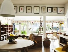 bunting, crocked frames....there is LIFE is this beautiful house :)