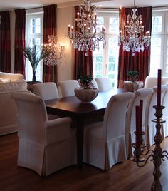 Love the 2 hanging chandeliers over the formal dining room table