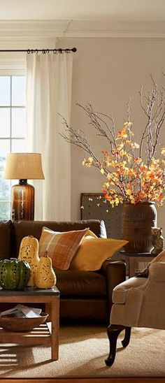 a colour palette of oranges, browns and reds creates a cosy warm autumn feel for the home
