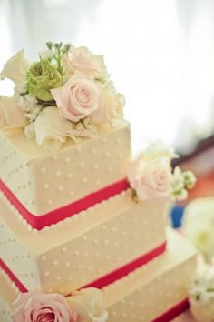 incorporated strips of hot pink for a playful and personal touch on their classic wedding cake fromFluffy Thoughts Cakes