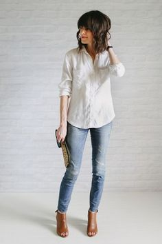 "So here we are, the last post … for a while at least. I don't think we could have finished on a more ""unfancy"" outfit. A white tee and jeans. Finished out with a front tuck, rolled jeans, ""no makeup"""