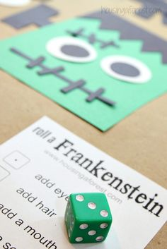 This cute party game, called Roll a Frankenstein, will be fun for the whole family. Make a craft project more interactive by rolling dice to see who can attach the most body parts to their Frankenstein first. Click through for a tutorial and more Halloween game ideas for this year's Halloween party.