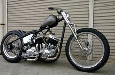 Big twin flathead hardtail with vintage dirt track front end