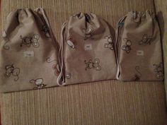 3 little rucksacks with printed fabric names