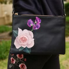 Hand Painted leather bags with florals to match your wedding bouquet! Order your own custom leather jacket from marypaintsweddings.com :)