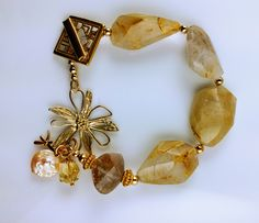 Rutilated Quartz link bracelet with gold plated findings.