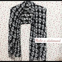 Skull scarf This trendy Black and white skull scarf will have all your friends talking! Take in all the compliments and flaunt this piece! Accessories Scarves & Wraps