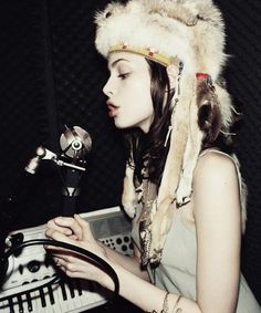 Charlotte Kemp looking very chic sauvage in an authentic quilted fur headdress at Wonderland, Hollywood, 2009.