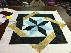Assembling the Labyrinth Quilt - half square triangles - - - one day I might try this!