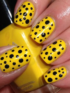 Darcy by Zoya & three different dotting tools, added assortment of dots using Konad black special polish attention grabber