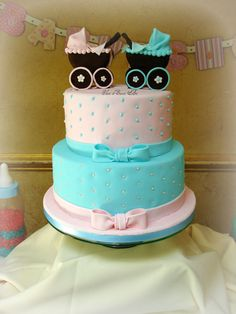 Baby Shower cake for twins featuring pink & blue baby carriage toppers