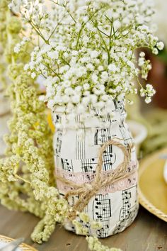 Mason jars wrapped in vintage music sheets