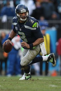 Russell Wilson Photos Photos: Divisional Round - Seattle Seahawks v Carolina…