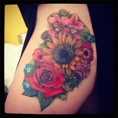 Flowers tattoo for a cover up - This woman had a zombie tattoo on her thigh and decided to cover it up with these charming flowers. She made the right choice this time. #TattooModels #tattoo