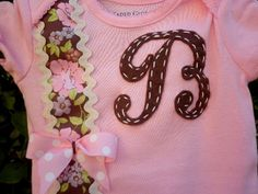 Baby girl boysuit accented with initial and beautiful